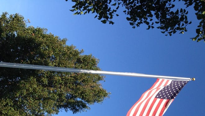 An American flag is shown at Cross Pointe Church of the Nazarene in Salisbury on Election Day 2014.