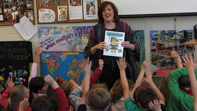 Shannon Hunt, president of the Nashville Public Education Foundation, visits students at Percy Priest Elementary.