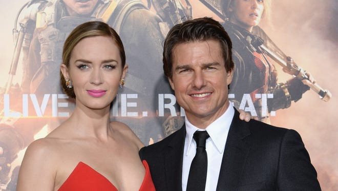 """Emily Blunt and Tom Cruise attend the """"Edge Of Tomorrow"""" red carpet repeat fan premiere tour at AMC Loews Lincoln Square on May 28, 2014 in New York City."""