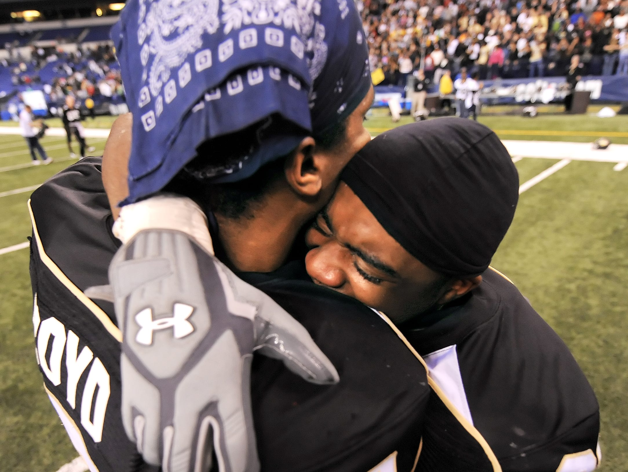Warren Central players Jerry Boyd, left, and David Smith celebrate their win over Carmel in double overtime in the 2009 Class 5A state football championship over Carmel. Todd Clark's crew missed a critical call in that game that hurt Carmel.