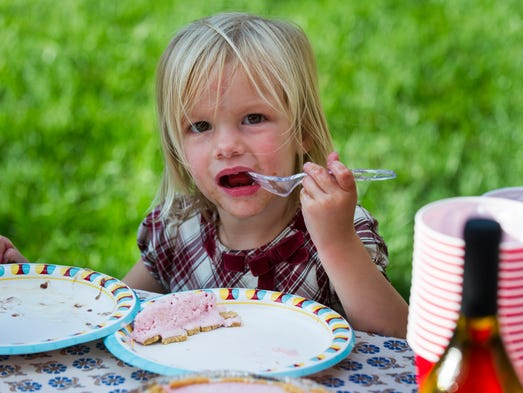 Helen Sinsabaugh, 2, enjoys a piece of pie. For eight years, six families in Fountain Square have met for the Sunday Supper Club. This Sunday, they will join with other families in the neighborhood for a city-wide Porch Party sponsored the Harrison Center, Indianapolis Downtown Inc and the Urban Times.