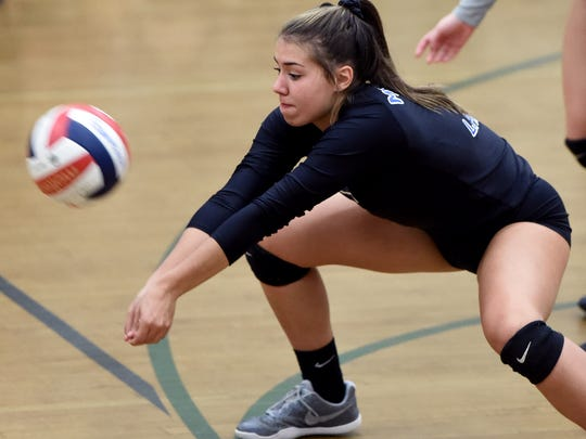 McQueen's Kaila Spevak digs for the ball during a game against Hug.