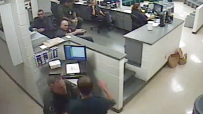 A photo taken from video of a Collier County jailhouse altercation between a deputy and William Naylor, right, in the early morning hours of Jan. 29, 2015. A federal lawsuit has been filed after mediation failed.
