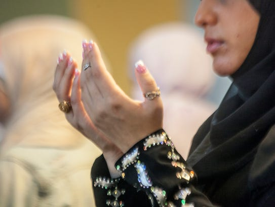 Muslims gather at the Islamic Center of America in Dearborn, Mich.