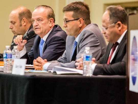 New Castle County Executive Thomas P. Gordon (second from left) speaks during a debate as Matt Meyer (second from right), who won the Democratic primary, listens at the Hockessin Memorial Hall on Aug. 2.