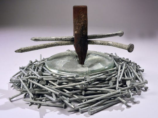 """""""Hammered Nails"""" sulpture by Jeep Johnson is featured in the exhibit."""