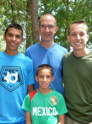 Kent Burbank, right, with husband Vicente Talanquer and sons Martin, 14, and Daniel, 12.