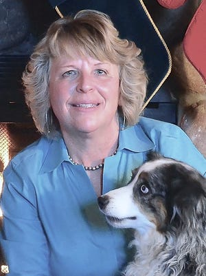 Ginger Moore, pictured with her dog Blue, is a recipient of a Hewett Award.