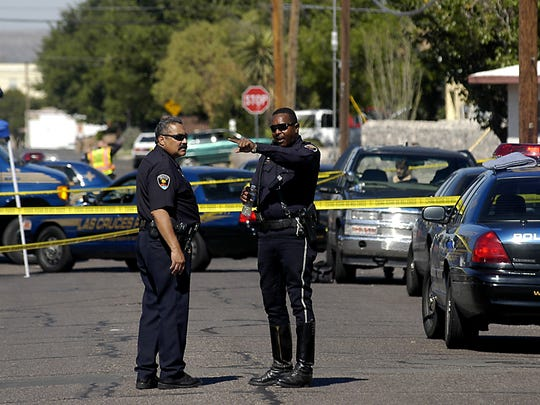 Las Cruces police officers J.R. Stewart, left, and Jimmie Brown secure the scene July 14, 2010, on Montana Avenue in response to an officer-involved shooting.