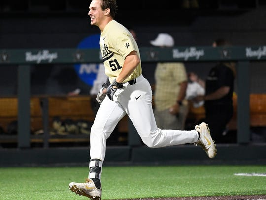Vanderbilt's J.J. Bleday (51) celebrates as he heads toward home after hitting a walk-off home run to beat Mississippi State 4-3.
