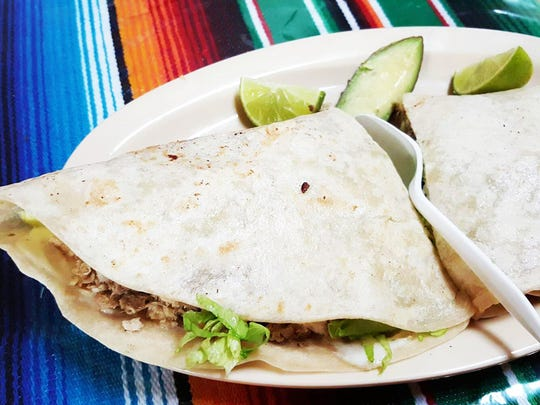 Montado is a large flour tortilla filled with lettuce, tomato and asadero cheese, with either beef or pork ($6.99). The plate comes with lime and avocado.