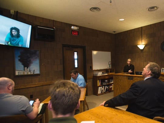 Via a live feed from the Ingham County jail, former MSU football player Auston Robertson, 19, is arraigned for 3rd degree criminal sexual conduct via video in Magistrate Mark Blumer's Ingham County 55th District court Tuesday, April 25, 2017, at the Ingham County Courthouse. Seated second from right is his attorney David Rosenberg.