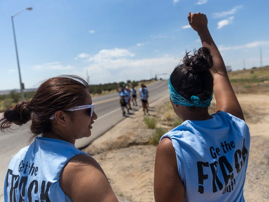 Andreanne Catt, left, and Lauren Howland prepared to join a group of runners Monday in Farmington who gathered at the Bureau of Land Management office in June of 2017 as part of a protest over extraction activities near the Chaco Culture National Historic Park.