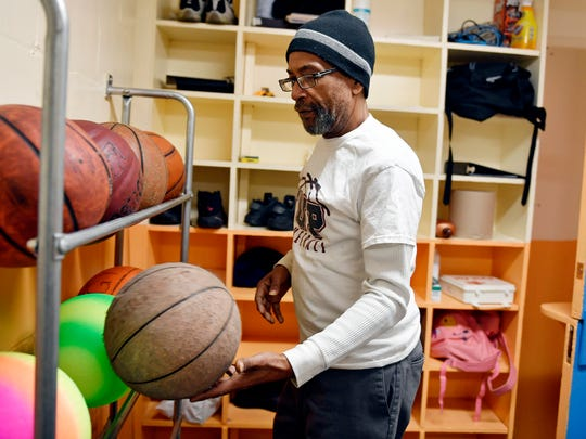 Louis Woodyard puts away basketballs Wednesday, April 11, 2018, at Voni Grimes Gym in York. Woodyard, who works part-time for the city at the gym and Memorial Park, was shot in a case of mistaken identity in October 2016. With help from friends, family and fellow musicians, Woodyard recovered physically but is still working through his Post-Traumatic Stress Disorder.