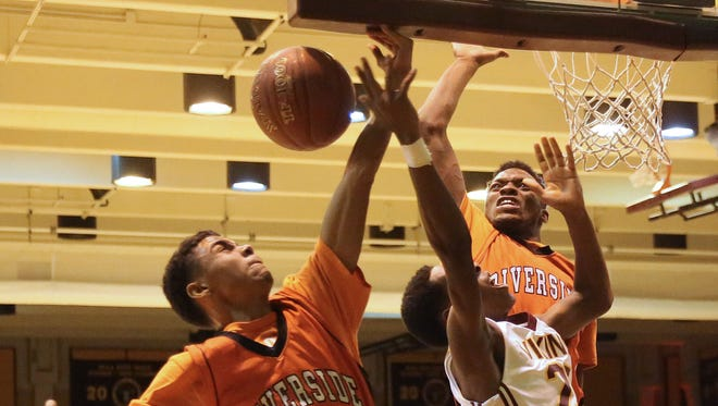 Vincent's Jerome Johnson Jr. has his shot blocked by Riverside's Jason Webb (left) and Carlos Curtis.