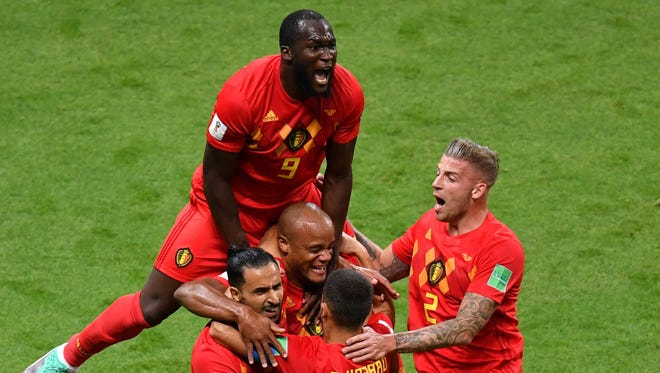 Belgium players celebrate the opening goal against Brazil.