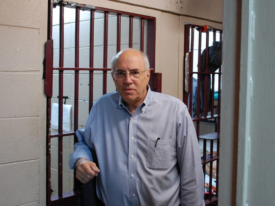 Ron Carver, an associate fellow at the Institute for Policy Reserch, stands in front of the Starkville jail cell where he was imprisoned as a civil rights worker in 1964. Carver was back in Mississippi for the Freedom Summer celebration.