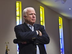 Facing conservative foe, John McCain says, 'Complete the danged fence'