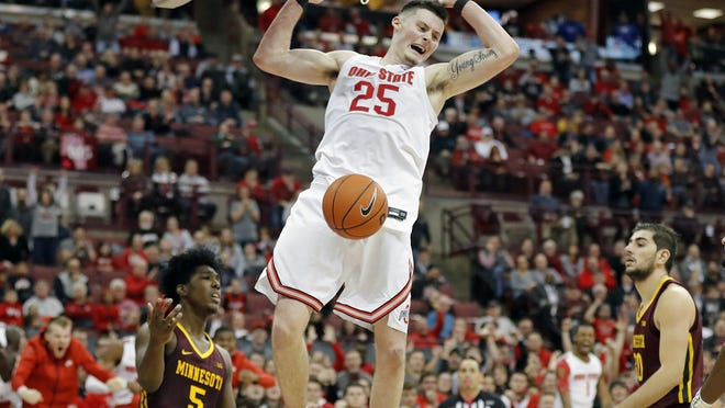 Kyle Young, dunking against Minnesota on Jan, 23, became a fan favorite for his gritty and passionate play.