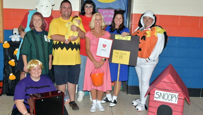 Third-grade teachers at Powell Elementary celebrated Halloween in 2017 like the Peanuts gang. Pictured at the trick-or-treating event are (seated) Mandi Meek (Schroeder); (back) Jill Cooper (Peppermint Patty), Jon Lakin (Linus), Caleb Bradley (Charlie Brown), Eleanora Bradley (Woodstock), Torey Hyder (Marcie), Candy Parker (Sally), Melissa Watson (Lucy) and Tina Corea (Snoopy).
