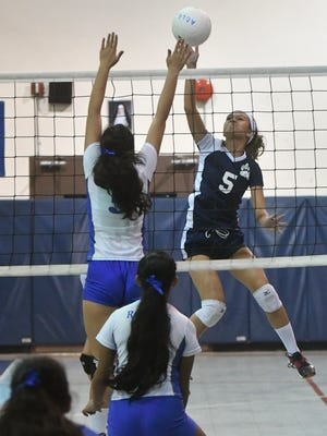 In this file photo, the Academy of Our Lady of Guam Cougars played the Notre Dame Royals in an Independent Interscholatic Athletic Association of Guam Girls' Volleyball League Semifinal at the AOLG gym on Oct. 18.  The Cougars will face off the top-seeded George Washington Geckos in the finals on Friday.