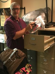 With donations constantly coming in and more than 350 students taking items for themselves, Cox has had to find creative ways to store the items he receives as donations, including using filing cabinets to hold new shirts.