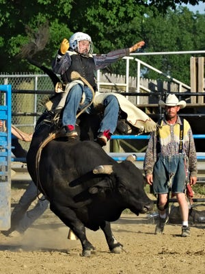 Enquirer reporter Nick Buckley is bucked off a bull during an amateur bull riding event at the Calhoun County Fairgrounds in Marshall on June 29, 2018.