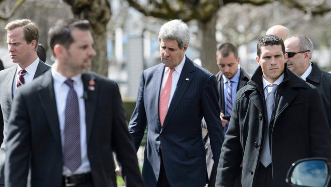 Secretary of State John Kerry walks outside the hotel during a break in the talks with Iran in Lausanne, Switzerland, on March 30. 2015.