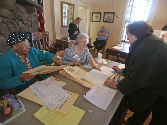 Election workers Doris Vasser, left, and Jean Black