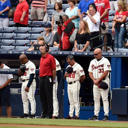 Atlanta Braves manager Fredi Gonzalez  and fans and