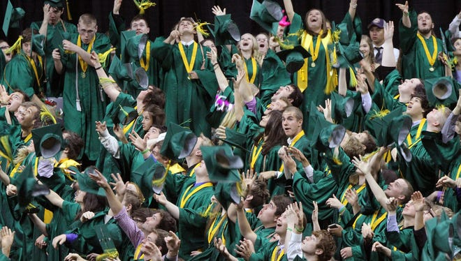 Graduating members of the Howell Class of 2015 toss their mortar boards into the air signaling the end of graduation ceremonies.