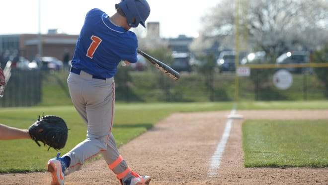 Millville's Hunter Sibley hits during Thursday's game against Vineland at Vineland High School. 04.12.18.