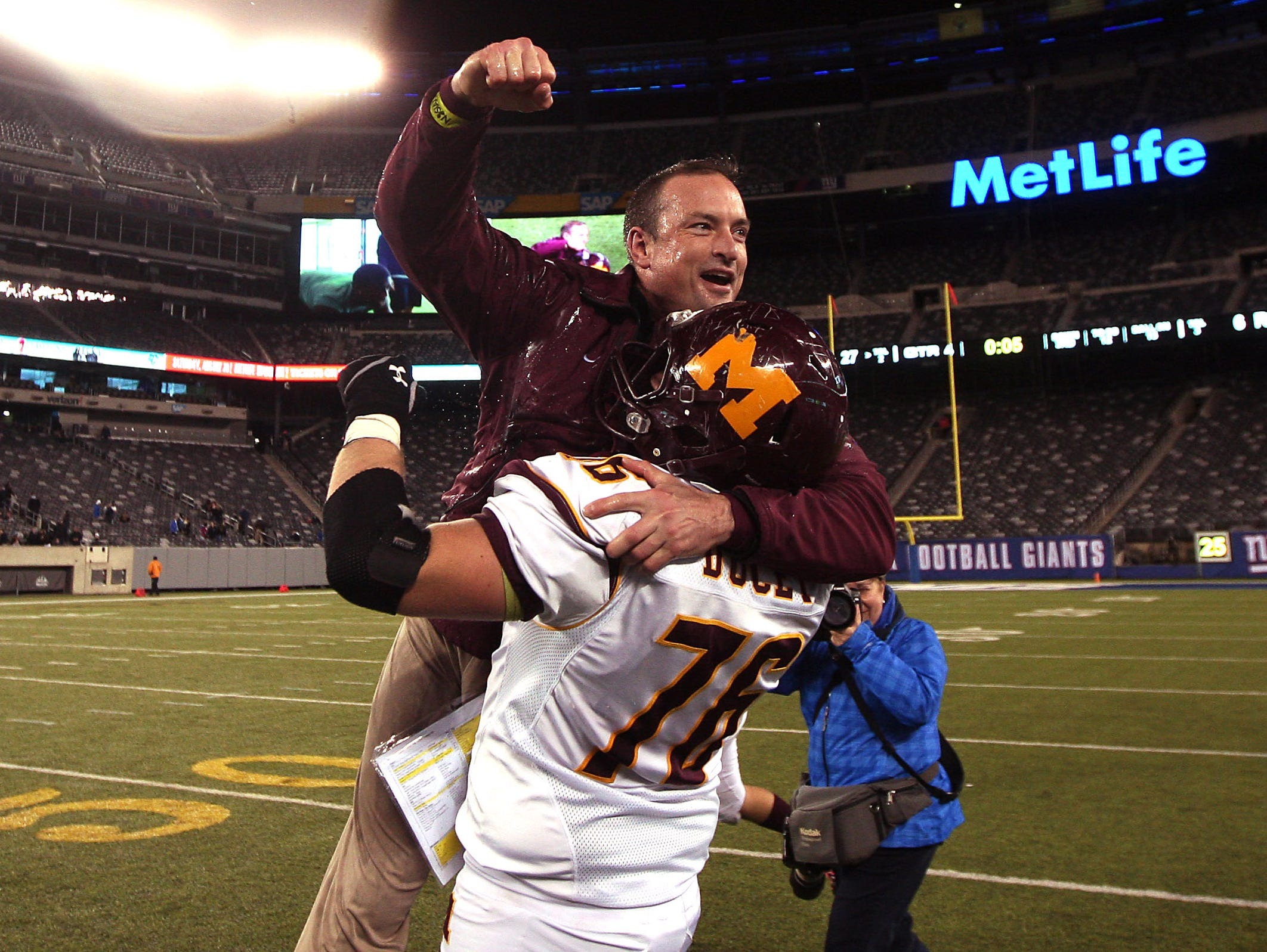 Madison Head Coach Chris Kubik is lifted up by Jake Ducey after the Dodgers beat Rutherford in the North 2, Group 2 NJSIAA football Championship at MetLife Stadium. Madison won 27-6. December 3, 2015, East Rutherford, NJ.