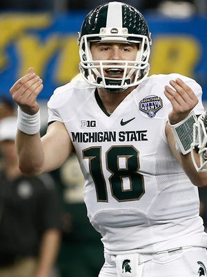 Michigan State quarterback Connor Cook signals to his teammates during the Cotton Bowl on Jan. 1, 2015, in Arlington, Texas.