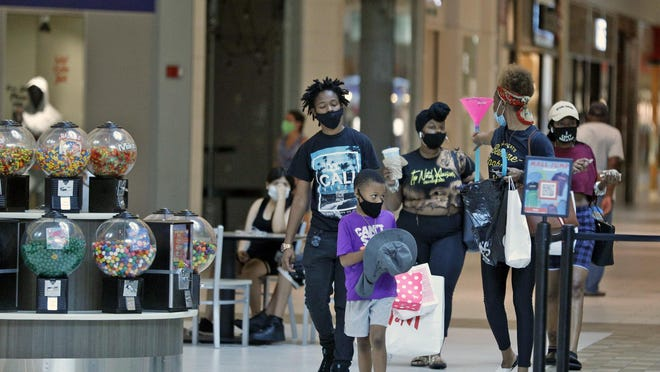 A family goes shopping this week at Volusia Mall. Both parents and merchants say that back-to-school shopping could look different this year because of uncertainty tied to the coronavirus pandemic. The state's back-to-school tax holiday is Aug. 7-9.