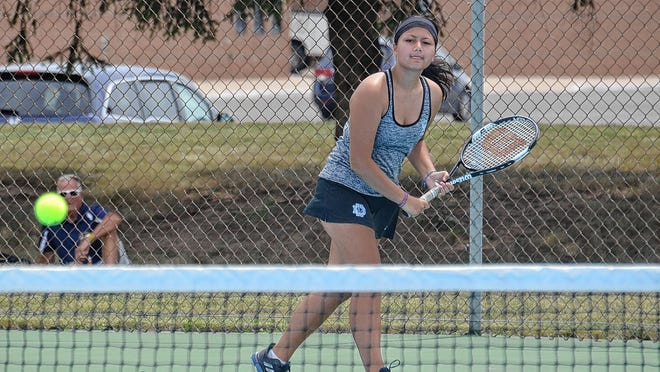 Chantrea Thip of the Darby girls tennis team volleys during a doubles match against Bradley on Aug. 12. Thip is one of 11 seniors for the Panthers and fourth-year coach Shawn Morris.