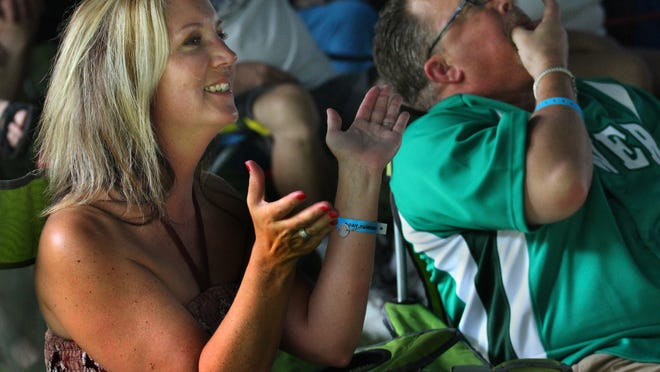 Julie Voiearmour claps while her husband Mark Voiearmour whistles in appreciation of the JW-Jones Blues Band's performance at the Big Bull Falls Blues Fest in Wausau, Saturday, August 16, 2014. The Voiearmours are from Kenosha.