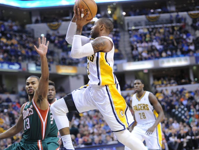 C. J. Watson flies to the basket to score after picking up a loose ball at mid-court. The Indiana Pacers hosted the Milwaukee Bucks in NBA action at Bankers Life Fieldhouse Thursday February 27, 2014.