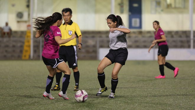 The Queen Cobras and Cars Plus/Jeep played in an opening day match of the Guam Football Association Women's Intermediate 7-A-Side Recreational League from Sunday at the GFA National Training Center.