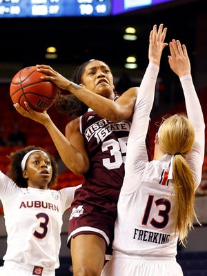 Mississippi State's Victoria Vivians is fouled by Auburn's Katie Frerking as she puts up a shot during the second half.