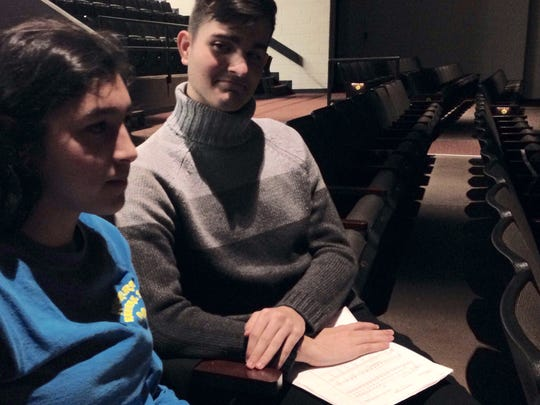 In this Jan. 2, 2016 photo, Josh Dennis, right, and a fellow student at James M. Bennett High School in Salisbury take a break after practicing singing parts for the Rock 'N' Roll Revival at the high school in February.