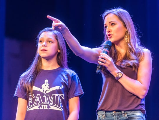 Laura Osnes gives advice to Logan Marciano during the