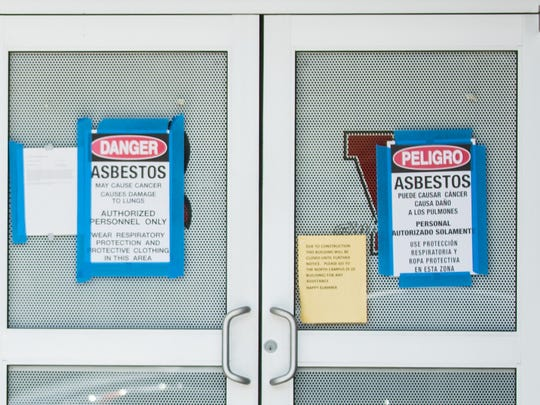 Asbestos warning signs have been posted at entrances around Vineland High School.