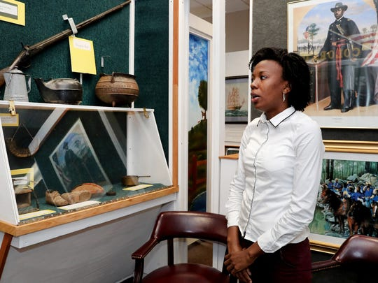 Vonchelle Stembridge, facility coordinator of Bradley Academy Museum and Cultural Center, talks about the African American heritage exhibits at the Murfreesboro landmark.