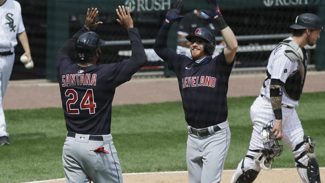 Cleveland Indians' Jordan Luplow, right, celebrates with Domingo Santana after hitting a two-run home run against the Chicago White Sox during the fourth inning of a baseball game in Chicago, Saturday, Aug. 8, 2020.