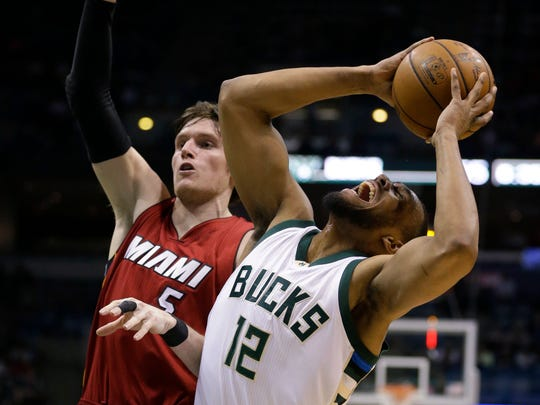 Jabari Parker grimaces in pain while tearing his ACL against the Miami Heat.