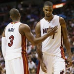 Heat go back to work, without Bosh at practice