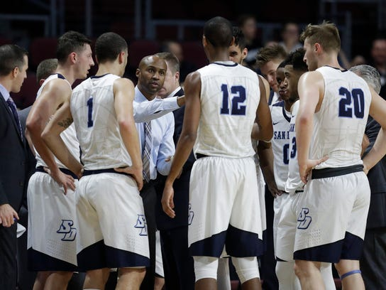 San Diego coach Lamont Smith talks to his players during the second half against Portland in a West Coast Conference tournament NCAA college basketball game Friday, March 3, 2017, in Las Vegas. Portland won 60-55. (AP Photo/John Locher)