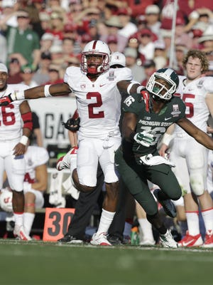 Stanford Cardinal cornerback Wayne Lyons tries to break up a pass to Michigan State Spartans wide receiver Aaron Burbridge during the 2014 Rose Bowl.