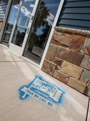 The Stubbornly Optimistic logo can be chalked-sprayed on sidewalks and driveways. Wisnet.com is offering to do it for community residents and businesses.
